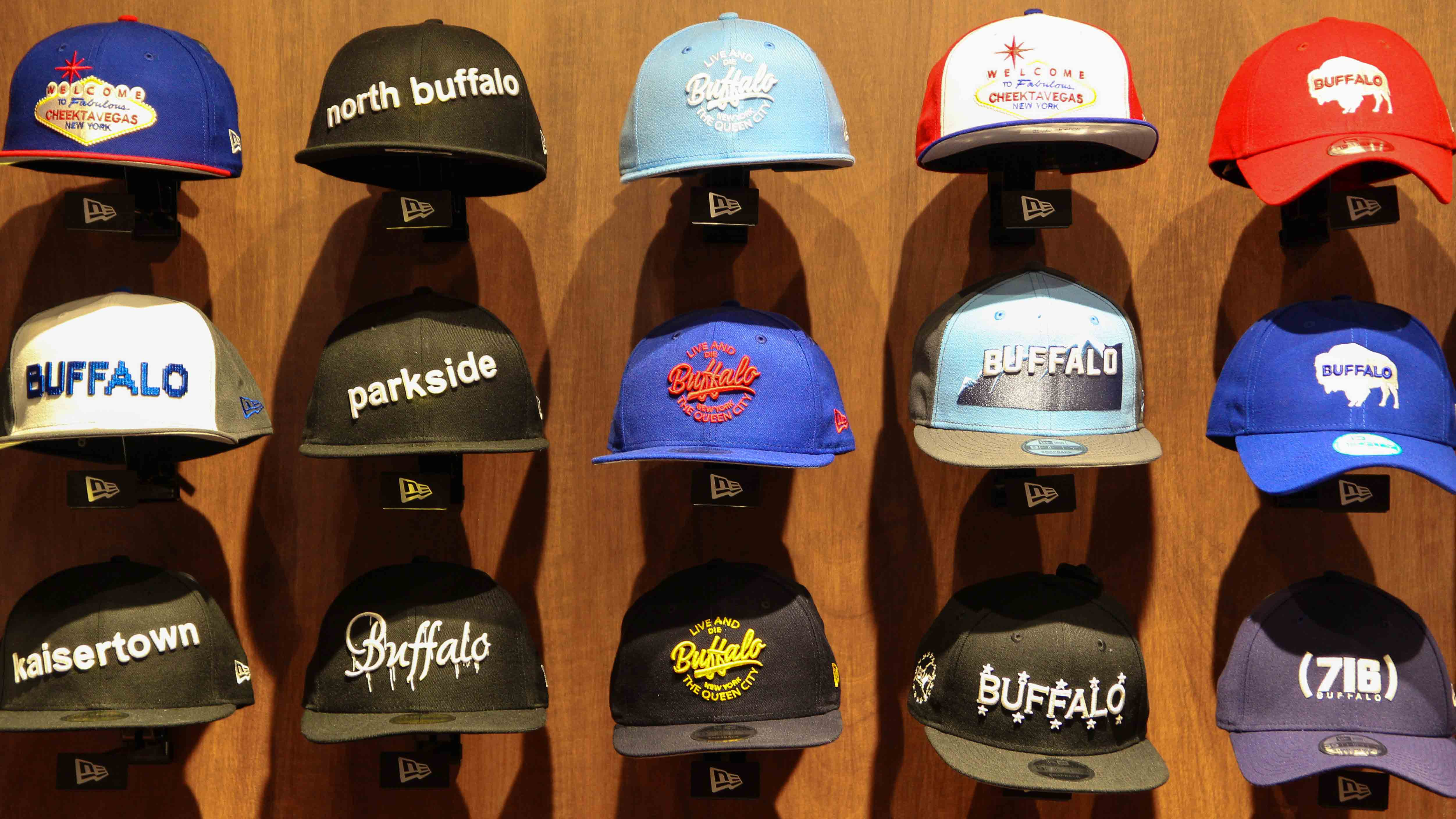 An entire wall is dedicated to Buffalo-themed hats unique to the store. Caps  are embroidered with Buffalo calling cards 0dbc973b28e2