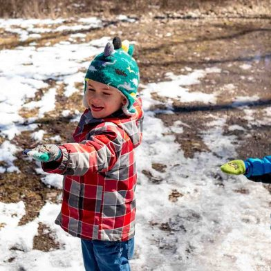 Children playing in the snow at Tifft Nature Preserve